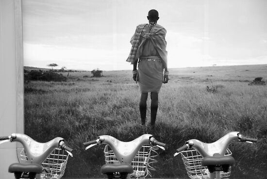 Maasai and his herd. by Jean-Luc Rollier