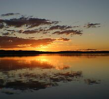 Fire in the Sky at Sunset on Tuggerah Lakes by Tam  Locke