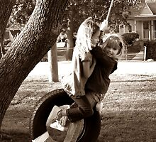 Life is a tire swing... by Tracy DeVore