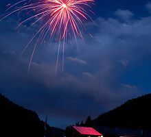 Fireworks over a Mountain Cabin by Bo Insogna