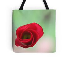The end of a great artwork - red whirlwind in a green paradise Tote Bag