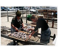 The Ladies Of Nazaré Tend Their Fish Poster