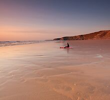 Gazing into the sunset - Watergate Bay, Cornwall, UK by Zoe Power