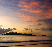 Sunrise over Dunk Island with clouds by Susan Kelly