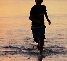 Sunset runner, Coral Bay Western Australia by ladieslounge