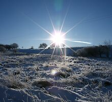 Sunrise over a snowy Britain by glenton