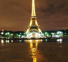 Two Golden Eiffel Towers at night by Daniel Knox