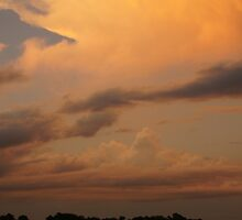 The golden clouds in Wakarusa by agenttomcat