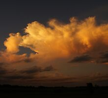 Sweeping golden clouds in Wakarusa by agenttomcat