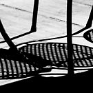 Sidewalk Cafe Shadows  by Laurie Minor