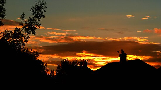 sunset Over suburbia by Thomas Scurr
