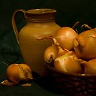 Onions basket on green backgraund by Margarita K