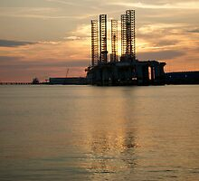 Drilling rig at sunset - Galveston, Texas by Ann Reece