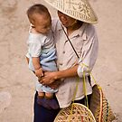 Hat Lady And Infant by phil decocco