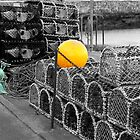 Lobster pots and yellow buoy (and green rope too) by David  Barker