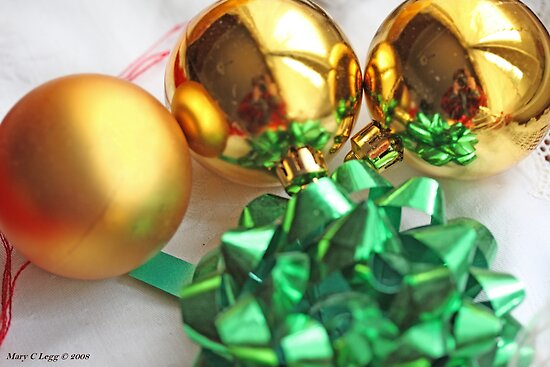Three gold Christmas balls with green ribbon by pogomcl