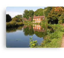 Cottages reflected in the Itchen Navigation, Winchester, southern England Canvas Print