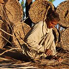 Making baskets from sticks by Emoto