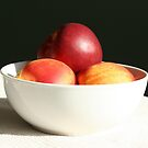 Nectarines, shadow and light by Sue Brown