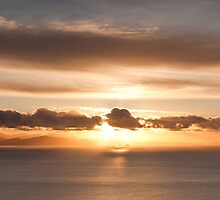 The South Island disappears in the glow of sunset by Brendon Doran