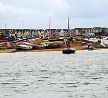 Beach Huts and boats at Hengistbury Head Dorset by Chris Day