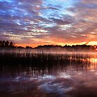 Sunset reflection on lake by Romeo Koitmäe