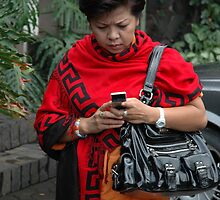 holding mobile phone by bayu harsa