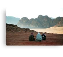 Three men in conversation. Canvas Print