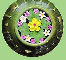 Thailand - Flowers floating in a green pot by DAdeSimone