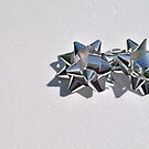 Christmas:  Silver Stars on a Bed of Sparkly Snow by Jen Waltmon