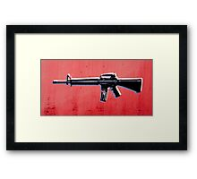 M16 Assault Rifle on Red Framed Print