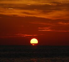 That Ol' Orange Ball in the Sky by Raina DeVaney