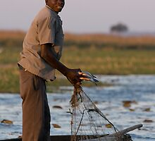 Namibian Fisherman, Chobe River by Neville Jones