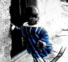 Little girl from the village standing in the doorway to her shack - Coffee Bay, Transkei by Glennisimo