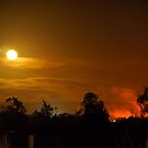 industrial moonrise thru refinery lights smoke by peterbeaton