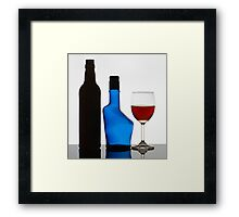 Wine Glass and The Empty Bottles. Framed Print