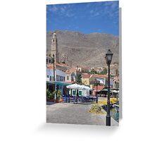 Towering over the Village Greeting Card