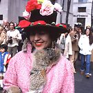 Lady with flowers on her hat, Fifth Ave., NYC by RonnieGinnever