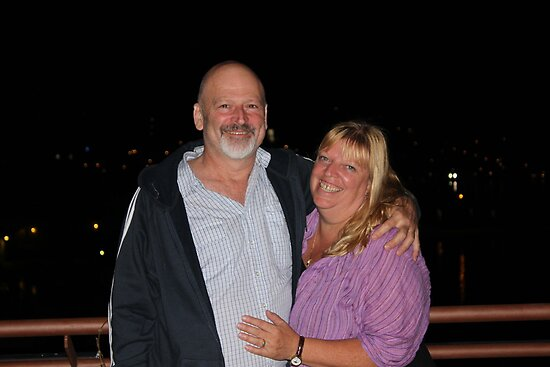 the happy couple on the roof top bar of thier motel in Poros by Doug Cliff