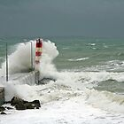 Portugal storm waves over a lighthouse. by Christa Knijff
