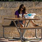 Girl at a Table by DJohnW
