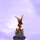 Golden statue outside Buckingham Palace - London by Naomi Seville