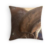 Used brown western saddle Throw Pillow