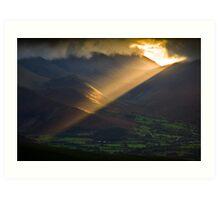 Golden rays on distant fells Art Print