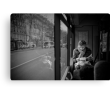 Reading in the bus Canvas Print