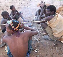 Tribal Bushmen Getting Ready for the Hunt by Nina Brandin