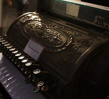 Old cash register by Oceanna Solloway