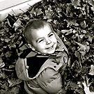 Tom loves the leaves ! by lendale