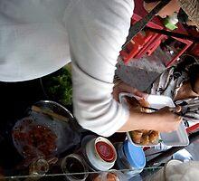 Preparing Street Food in Saigon by Sergey Kahn