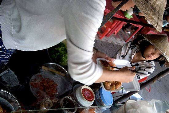 Preparing Street Food in Saigon by Sergey Kahn